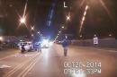 FILE - In this Oct. 20, 2014 frame from dash-cam video provided by the Chicago Police Department, Laquan McDonald, right, walks down the street moments before being shot by officer Jason Van Dyke in Chicago. Amid an outcry after the city waited more than a year to release dash-cam footage of Officer Van Dyke shooting McDonald 16 times, Mayor Rahm Emanuel announced this week that he was setting up a special task force to examine, among other things, the city's video-release policy. (Chicago Police Department via AP, File)
