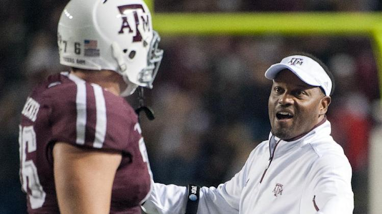 Texas A&M head coach Kevin Sumlin, right, congratulates Luke Joeckel, left, after a score during the second quarter of an NCAA college football game against Missouri, Saturday, Nov. 24, 2012, in College Station, Texas. (AP Photo/Dave Einsel)