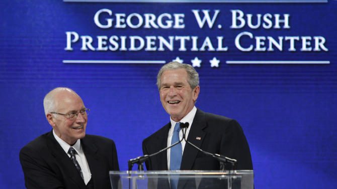 Former President George W. Bush, right, shakes hands with former Vice President Dick Cheney after Cheney introduced Bush during the groundbreaking ceremony for the  President George W. Bush Presidential Center in Dallas,  Tuesday, Nov. 16, 2010. (AP Photo/LM Otero)