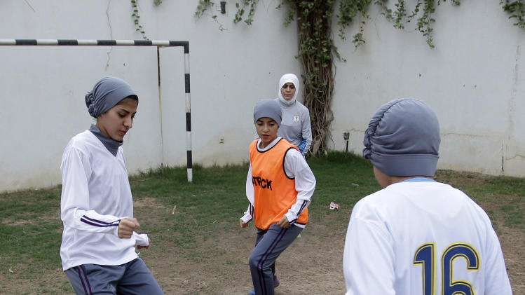 In this May 21, 2012 photo, members of a female soccer team practice at a secret location in Riyadh, Saudi Arabia. While Olympic leaders and human rights advocates are encouraged by signs that Saudi Arabia may bow to pressure and send female athletes to the Summer Games, women athletes in the ultraconservative kingdom are worried about a backlash at home. (AP Photo/Hassan Ammar)