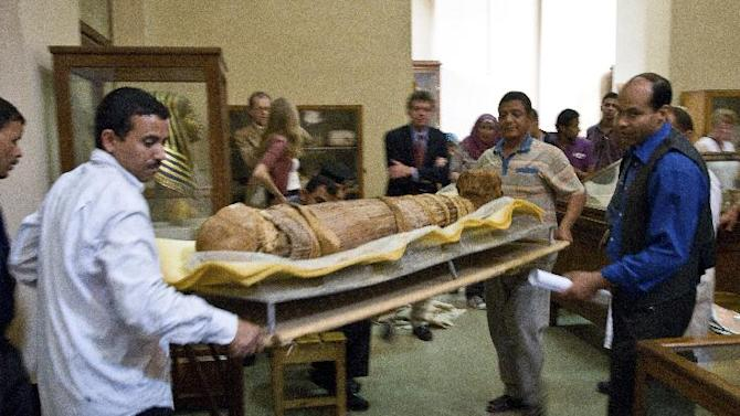 In this undated photo released Sunday March 10, 2013, by a group of cardiologists lead by Saint Luke's Mid America Heart Institute in Kansas City, USA, showing the mummy Hatiay (New Kingdom, 18th Dynasty, 1550 to 1295 BCE) as it is returned to its display back in the Antiquities Museaum in Cairo after it underwent a CT scanning. This scanning is part of a major survey to investigate some 137 mummies which has revealed that people probably had clogged arteries and heart disease some 4,000 years ago.  CT scans of 137 mummies showed evidence of atherosclerosis, or hardened arteries, in one third of those examined, including those from ancient people believed to have healthy lifestyles. (AP Photo/Dr. Michael Miyamoto)