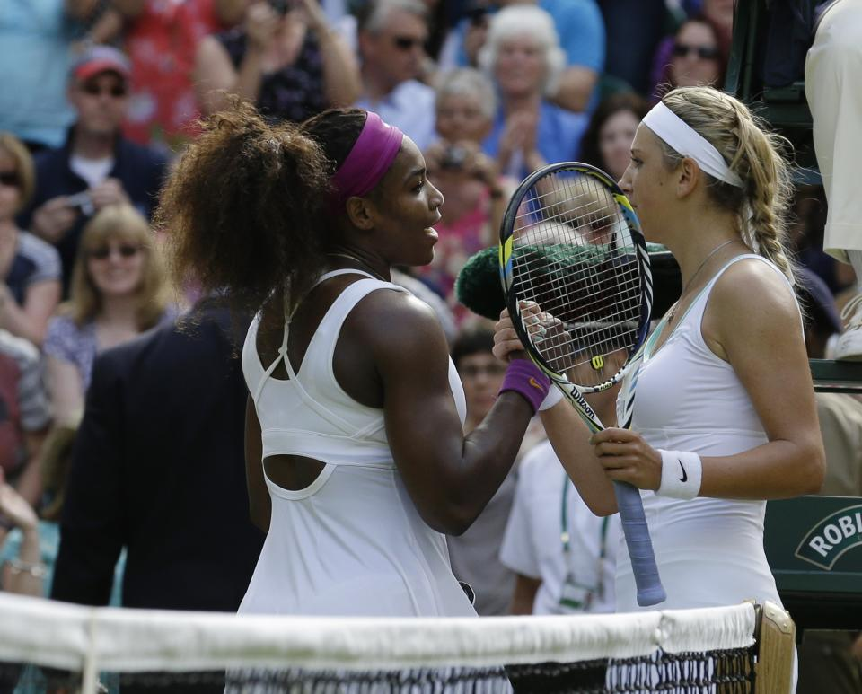Serena Williams of the United States, left, is congratulated by Victoria Azarenka of Belarus during a semifinals match at the All England Lawn Tennis Championships at Wimbledon, England, Thursday, July 5, 2012. (AP Photo/Anja Niedringhaus)