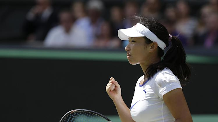 Zheng Jie of China reacts after winning the first set against Serena Williams of the United States during a third round women's singles match at the All England Lawn Tennis Championships at Wimbledon, England, Saturday, June 30, 2012. (AP Photo/Anja Niedringhaus)
