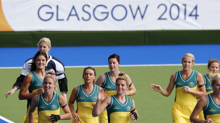 Australia's hockey team members run victory lap after defeating Malaysia in preliminary match at 2014 Commonwealth Games in Glasgow, Scotland
