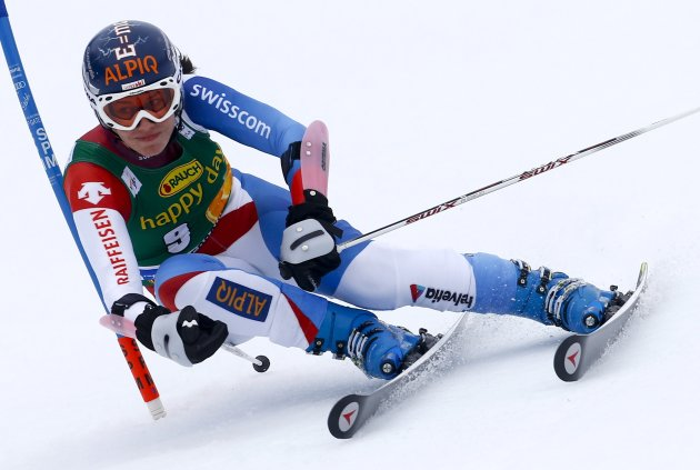 Gisin of Switzerland clears a gate during the women's Alpine Skiing World Cup giant slalom race in Ofterschwang