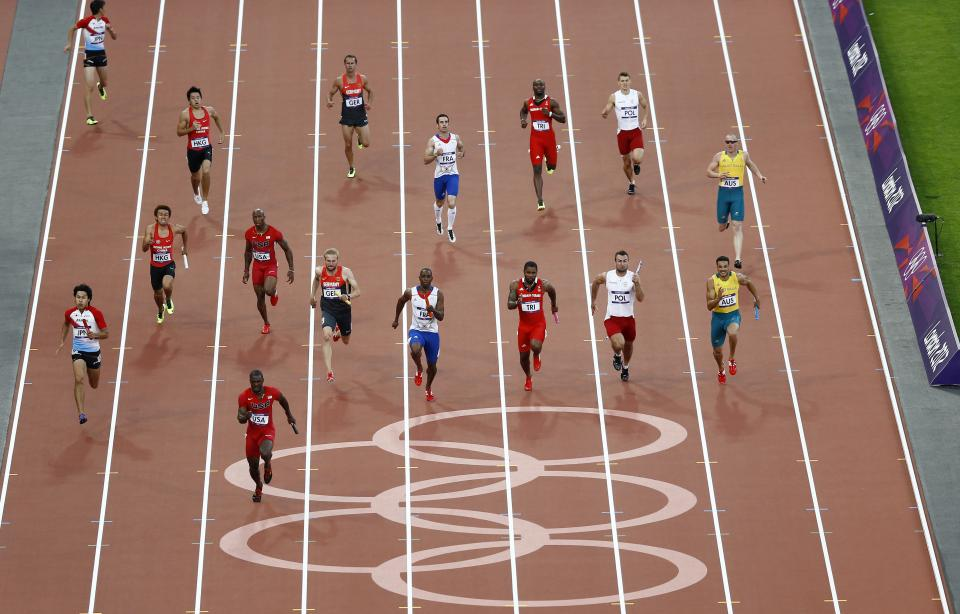 United States' Justin Gatlin leads the field in a heat of the mens 4x100-meter relay during the athletics in the Olympic Stadium at the 2012 Summer Olympics, London, Friday, Aug. 10, 2012. (AP Photo/Daniel Ochoa De Olza)