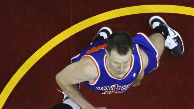 Cleveland Cavaliers' Kyrie, bottom, Irving shoots inside New York Knicks' Steve Novak in the second quarter of an NBA basketball game on Friday, April 12, 2013, in Cleveland. (AP Photo/Mark Duncan)