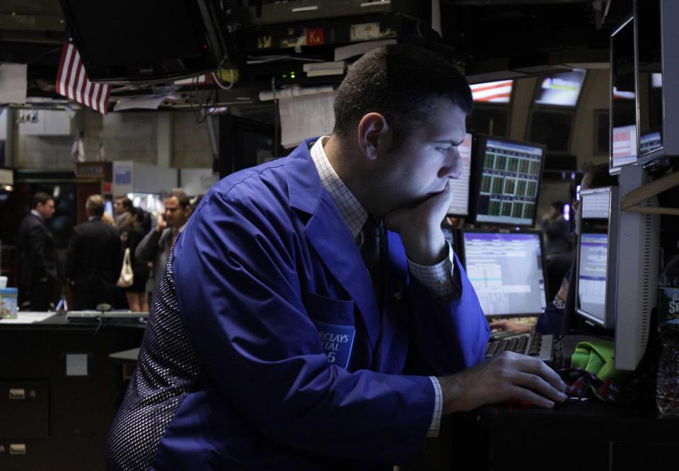 A specialist studies his screen as he works on the floor of the New York Stock Exchange Monday, Sept. 19, 2011. (AP Photo/Richard Drew)