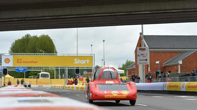 IMAGE DISTRIBUTED FOR SHELL - The Berlinette II, vehicle No. 718, UrbanConcept, running on Battery Electric w/ Solar Panel, competing for team electricar solution from Lycee des metiers de l'energie dans les systemes automatises, France, on the track during day 2 of competition at the Shell Eco-marathon Challenge Europe held at The Ahoy centre in Rotterdam, The Netherlands on  Friday, May 18, 2013. The car won first prize in the Battery Electric category. Teams from universities all over Europe have brought their energy efficient cars to compete through the three-day challenge. (Ermindo Armino/AP Images for Shell)