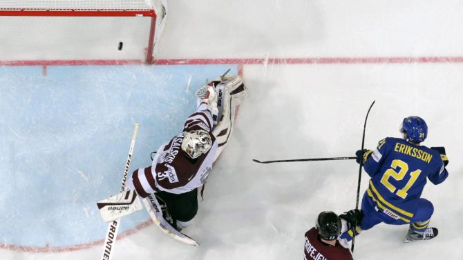 Sweden's Eriksson scores past Latvia's goaltender Masalskis during their Ice Hockey World Championship game at the O2 arena in Prague