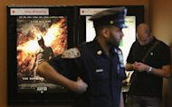 An NYPD officer keeps watch inside an AMC move theater where the film &#39;The Dark Knight Rises&#39; is playing in Times Square on July 20 in New York City. The most recent Batman movie &quot;The Dark Knight Rises&quot; had the third largest opening weekend ever, despite the movie theater massacre in Aurora, Colorado, according to figures released Monday