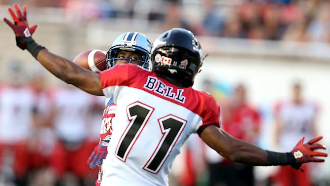 Montreal Alouettes' quarterback Rakeem Cato throws a pass against the Calgary Stampeders during the second half of their CFL football game in Montreal