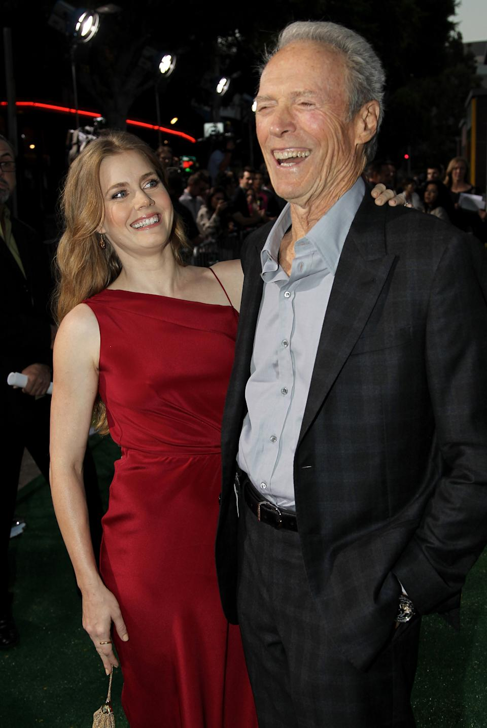 "Cast members Clint Eastwood, right, and Amy Adams pose together at the premiere of ""Trouble With the Curve"" at the Westwood Village Theater on Wednesday, Sept. 19, 2012, in Los Angeles. (Photo by Matt Sayles/Invision/AP)"