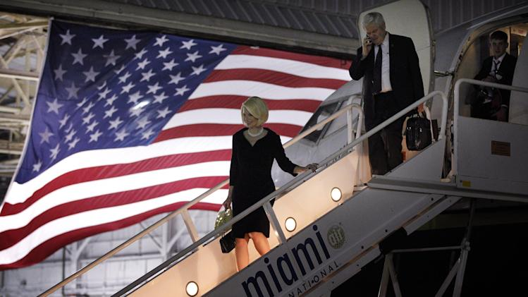 Republican presidential candidate former House Speaker Newt Gingrich accompanied by his wife Callista disembarks from a airplane Friday, Jan. 27, 2012, in Miami, Fla. (AP Photo/Matt Rourke)