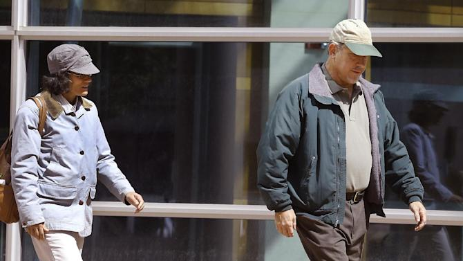 In this Sept. 10, 2014 photo, Ana and John Conley, parents of defendant Shannon Conley, exit the U.S. Federal courthouse following their daughter's plea hearing, at the U.S. Federal Courthouse, in Denver.   Shannon Conley, a 19-year-old suburban Denver woman who federal authorities say intended to wage jihad has pleaded guilty under a deal that requires her to give authorities information about others with the same intentions.   With foreign fighters from dozens of nations pouring into the Middle East to join the Islamic State group and other terrorist organizations, U.S. officials are putting new energy into trying to understand what radicalizes people far removed from the fight and into prodding countries around the world to do a better job of keeping them from joining up.  (AP Photo/Brennan Linsley)