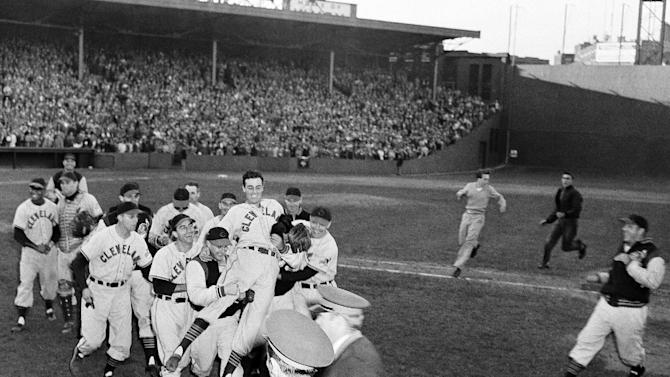 FILE - In this Oct. 4, 1948, file photo, Cleveland Indians pitcher Gene Bearden is carried off the field by teammates after their 8-3 win over the Boston Red Sox in a baseball game for the American League pennant at Fenway Park in Boston. The Indians advanced to the World Series, where they beat another Boston team _ the Braves _ in six games. The Associated Press takes a look at the nine one-game playoffs in major league history. (AP Photo/File)