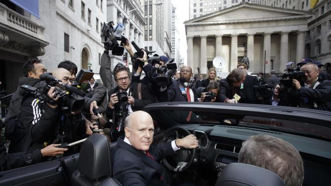 FILE - In this Thursday, Nov. 18, 2010, file photo, General Motors Co. CEO Daniel Akerson sits in the driver's seat of a 2011 Chevrolet Camaro parked in front of the New York Stock Exchange following GM's initial public offering. The U.S. government said Wednesday, Dec. 19, 2012, that it will sell its remaining stake in General Motors in the next year or so, winding down a $50 billion bailout that saved the iconic American car giant but also set off a heated debate about government intervention in private business that influenced this year's presidential election. (AP Photo/Mark Lennihan)