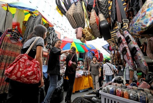 &lt;p&gt;Shoppers browse stalls at Namdaemun market in Seoul. South Korea on Monday unveiled new stimulus measures worth $5.2 billion to boost domestic demand as its export-driven economy struggles with the global economic downturn.&lt;/p&gt;