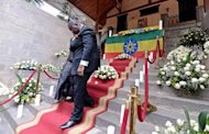 Malawi's Deputy Prime Minister Khumbo Kachali leaves the prime minister's palace in Addis Ababa after paying his respects to Ethiopia's longtime Prime Minister Meles Zenawi, who died. Tens of thousands of Ethiopians mourned Zenawi, in the first state funeral staged for a leader of the Horn of Africa nation in more than 80 years