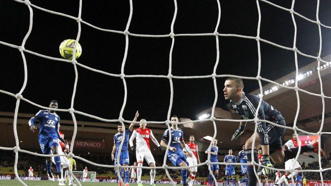Lyon's goalkeeper Anthony Lopes looks at the ball during their Ligue1 soccer match against Monaco in Monaco