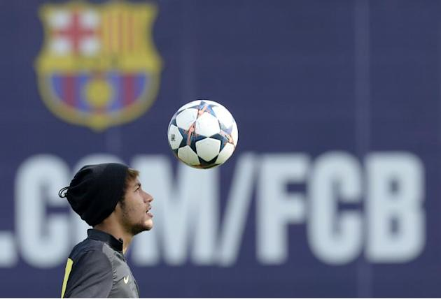 Barcelona's Brazilian forward Neymar da Silva Santos Junior takes part in a training session at the Sports Center FC Barcelona Joan Gamper in Sant Joan Despi near Barcelona on March 11, 2014