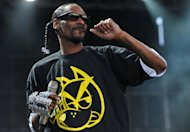 "FILE - In a July 7, 2011 file photo US hip-hop artist Snoop Dogg performs on stage at the Balaton Sound festival in Zamardi, Hungary. ""People are learning how to live and get along more, and accept people for who they are and not bash them or hurt them because they're different,"" Snoop said in a recent interview. (AP Photo/MTI, Tamas Kovacs, File)"