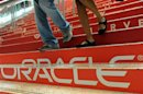 Attendees walk down branded steps at the 29th Oracle OpenWorld in San Francisco