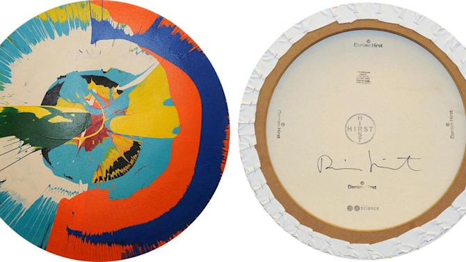 This undated photo provided by the Manhattan District Attorney's Office shows the front and back of a counterfeit Damien Hirst spin painting. Kevin Sutherland, a Miami pastor, knowingly peddled phony examples of some of British art star Damien Hirst's signature themes, prosecutors said in summing up Sutherland's attempted grand larceny trial Monday, April 7, 2014, but the defense claims he was just an art-market novice who couldn't read red flags about the pieces' authenticity. Jury deliberations are scheduled to resume Tuesday. (AP Photo/Manhattan District Attorney's Office)