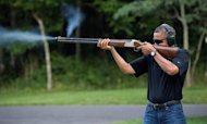 White House Releases Photo Of Obama Firing Gun