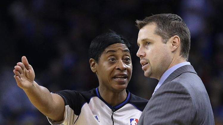 , speaks with referee Violet Palmer during the first half of an NBA