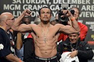 LAS VEGAS, NV - DECEMBER 07:  Boxer Juan Manuel Marquez poses on the scale during the official weigh-in for his welterweight bout against Manny Pacquiao at the MGM Grand Garden Arena on December 7, 2012 in Las Vegas, Nevada. Pacquiao and Marquez will fight each other for the fourth time on December 8 in Las Vegas.  (Photo by Jeff Bottari/Getty Images)