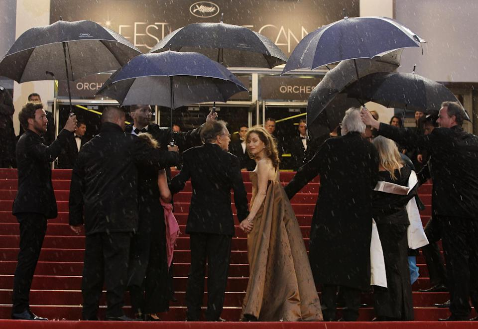 Actors Jean-Louis Trintignant, third left, Isabelle Huppert and director Michael Haneke arrive for the screening of Love at the 65th international film festival, in Cannes, southern France, Sunday, May 20, 2012. (AP Photo/Francois Mori)