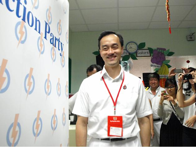PAP's Dr Koh Poh Koon arrives at the party's Punggol East branch to watch the results.