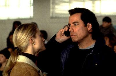 Teri Polo and John Travolta in Paramount's Domestic Disturbance