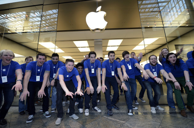 FILE-In this Friday, March 16, 2012, photo, Apple employees welcome hundreds of customers in front of the Apple store at a shopping mall in Oberhausen, western Germany, as the new iPad goes on sale at the Apple store. On Monday, Aug. 20, 2012, Apple set a new record for the most valuable company at $621 billion, beating Microsoft's 1999 high. (AP Photo/Martin Meissner, File)