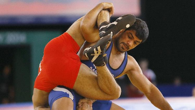 Sushil Kumar of India, right, wrestles with Qamar Abbas of Pakistan in a FS 74kg gold medal wrestling match at the Scottish Exhibition Conference Centre during the Commonwealth Games 2014 in Glasgow, Scotland, Tuesday July 29, 2014