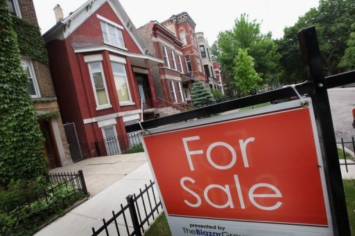 "<p>A ""For Sale"" sign stands is seen in front of a house in Chicago. US President Barack Obama has urged Americans to pressure Congress to pass his mortgage refinancing plan, arguing it would help working families and strengthen the middle class.</p>"