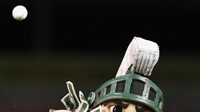 """The Michigan State University mascot """"Sparty"""" throws out the ceremonial first pitch before a baseball game between the Houston Astros and the Chicago Cubs at Wrigley Field in Chicago, Monday, Oct. 1, 2012. (AP Photo/Paul Beaty)"""