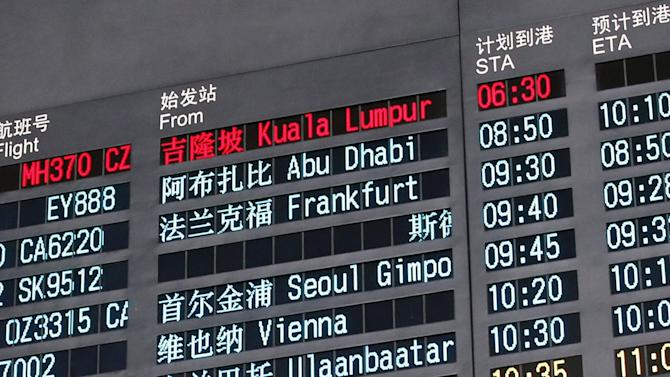 File photograph of a flight information board displaying the details of Malaysia Airlines flight MH370 at the Beijing Capital International Airport