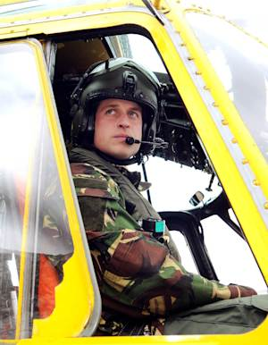 """FILE - In this March 31, 2011 file photo, Britain's Prince William, the Duke of Cambridge and a Royal Air Force helicopter pilot, sits at the controls of a Sea King helicopter. Prince William will be deployed to the politically sensitive Falkland Islands in 2012 as an air force search and rescue pilot, according to Britain's defense ministry. Prince William's deployment is a sore point for Argentina, whose foreign ministry complained on Tuesday Jan. 31, 2012 that the royal """"will arrive on our soil in the uniform of a conquistador, and not with the wisdom of a statesman who works for peace and dialogue between nations,"""" after Britain announced that it is sending an advanced warship to the disputed South Atlantic archipelago, which Argentina claims as the Malvinas Islands.  (AP Photo/John Stillwell/PA, File) UNITED KINGDOM OUT"""