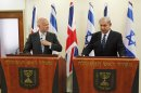 Britain's Foreign Secretary William Hague, left, listens to Israeli Prime Minister Benjamin Netanyahu during a joint news conference before their meeting in Jerusalem, Thursday, May 23, 2013. (AP Photo/Ronen Zvulun, Pool)