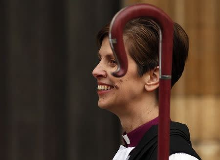 The first female bishop in the Church of England Libby Lane smiles following her consecration service at York Minster in York, northern England