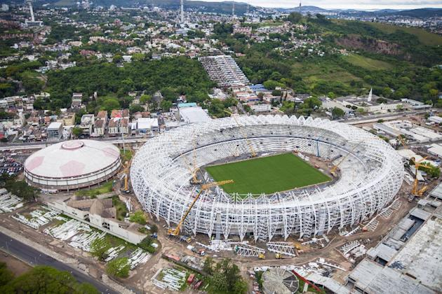 In this photo released by Portal da Copa 2014, an aerial view of the Arena Beira Rio stadium, in Porto Alegre, Brazil, Oct. 2013. The draw for the 2014 World Cup finals takes place Friday Dec. 6, 2013