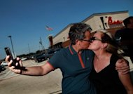 A couple kiss outside a Chick-fil-A restaurant on August 3, in Dallas, Texas. Gays and lesbians puckered up at &quot;kiss-ins&quot; outside Chick-fil-A outlets across the United States in protest over the fast-food chain&#39;s opposition to same-sex marriage
