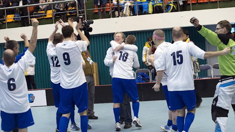 IMAGE DISTRIBUTED FOR SPECIAL OLYMPICS - The Finnish team celebrate their victory  during the final match between Russia and Finland at the floorball event of the 2013 PyeongChang Special Olympics World Winter Games in Gangneung, S. Korea on the third day of the competition, Thursday, Jan. 31, 2013. (Manchul Kim/AP Images for Special Olympics)