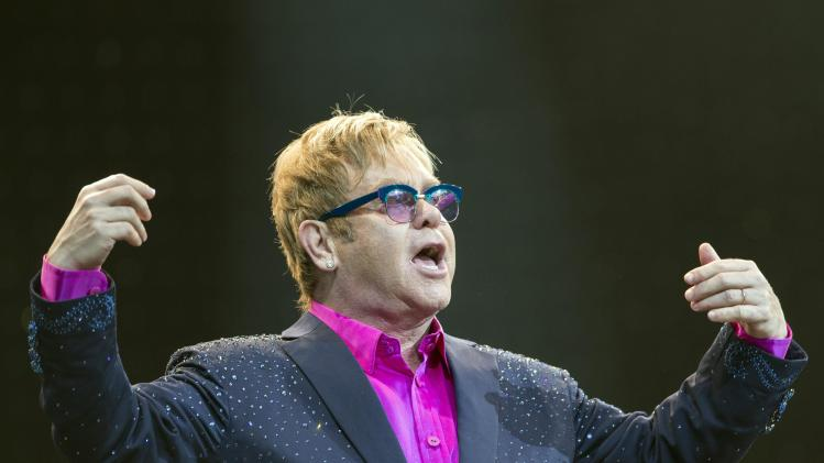 In this picture made available Friday, Sept. 6, 2013, Sir Elton John performs on the Waldbuehne stage in Berlin, Germany, Thursday, Sept. 5, 2013. British musician John gives five concerts in Germany during his 'Greatest Hits Live Tour 2013'. (AP Photo/dpa, Florian Schuh)