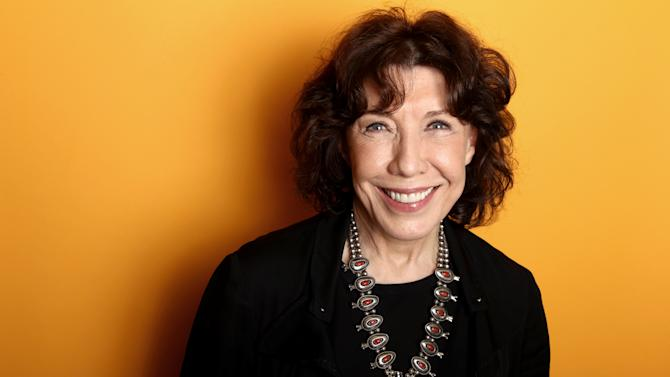 """In this Friday, March 15, 2013 photo, actress Lily Tomlin poses for a portrait at the Four Seasons Hotel, in Los Angeles. For Tomlin, 70 is the new 30, at least momentarily. In the Paul Weitz directed comedy """"Admission,"""" opening March 22, Tomlin plays the young-at-heart feminist mother of a university admissions officer, portrayed by Tina Fey.  (Photo by Matt Sayles/Invision/AP)"""