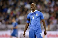 Italy's forward Mario Balotelli reacts after missing an opportunity to score during a friendly football match against Russia in Zurich. Russia won 3-0