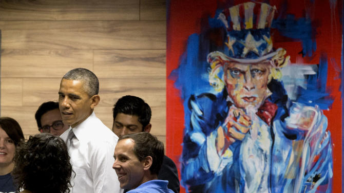"President Barack Obama stands next to a painting of ""Uncle Sam,"" during a visit with workers at 1776, a hub for tech startups, Thursday, July 3, 2014, in Washington. The president said job growth in June shows the recovery is taking hold, but the economy could still do better, he also urged Congress to work with him to help create more jobs. (AP Photo/Jacquelyn Martin)"