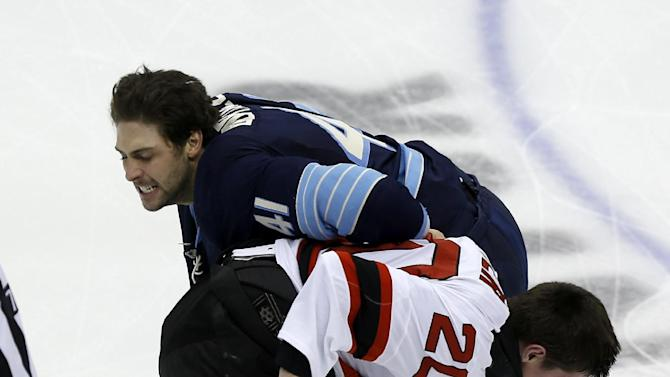 Pittsburgh Penguins' Robert Bortuzzo (41) and New Jersey Devils' Ryan Carter (20) fight just four seconds into the first period of an NHL hockey game on Sunday, Feb. 10, 2013, in Pittsburgh. Both were penalized for fighting. (AP Photo/Keith Srakocic)